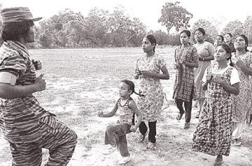 Female LTTE cadre training civilians